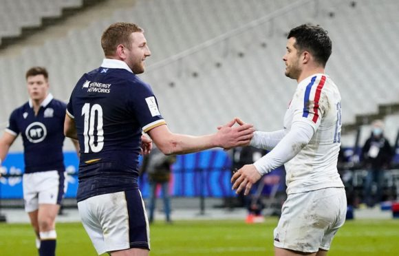 Finn Russell and Brice Dulin after the clash which brought Russell's red card in Paris.