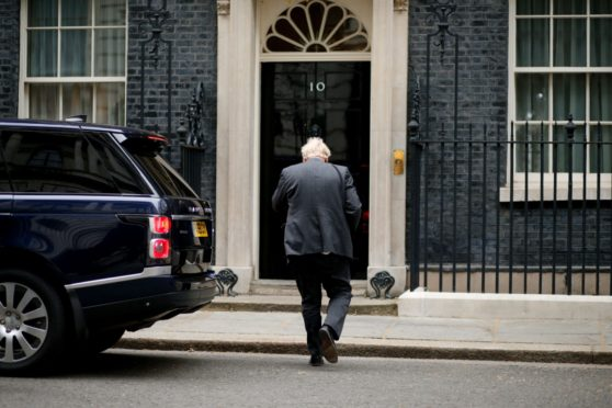 Boris Johnson enters 10 Downing Street.