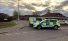 Police have sealed off a street in Whitfield.