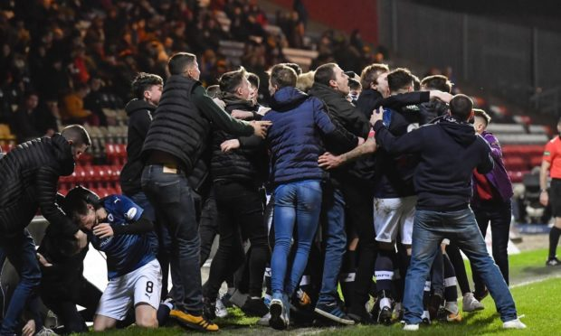 Raith Rovers players celebrate with supporters at Firhill