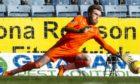 Zander Clark makes the vital penalty save.
