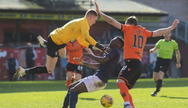 DUNDEE, SCOTLAND - APRIL 03: Dunfermline's Kieran Smith and Mouhamed Niang clash into each other before Nicky Clark scores the match winner making it 2-1 during a Scottish Cup Third Round tie between Dundee United and Partick Thistle at Tannadice Park, on April 03, 2021, in Dundee, Scotland. (Photo by Mark Scates / SNS Group)