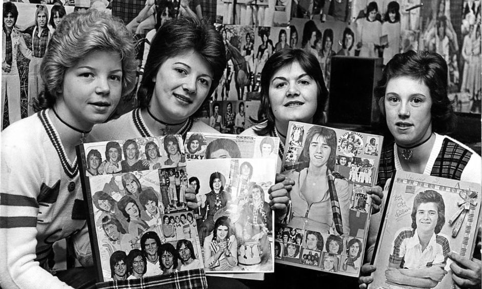 Rollers fans Liz Tosh, Gladys Wiseman, Linda Mann and Teresa Stewart who queued up all night in the pouring rain to have first choice of tickets for the Bay City Rollers concert at the Caird Hall in May 1975.
