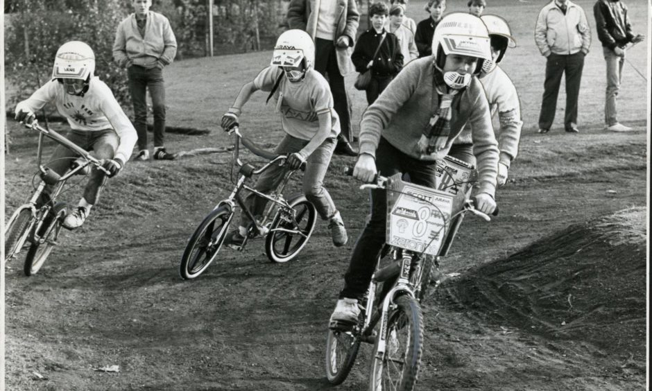 A group of youngsters negotiate a corner on the South Road Park BMX racing track in Dundee in 1984.