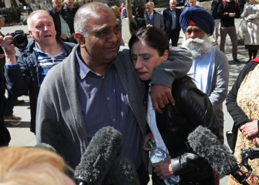 Postmaster Harjinder Butoy and wife Balbinder following the Horizon ruling.