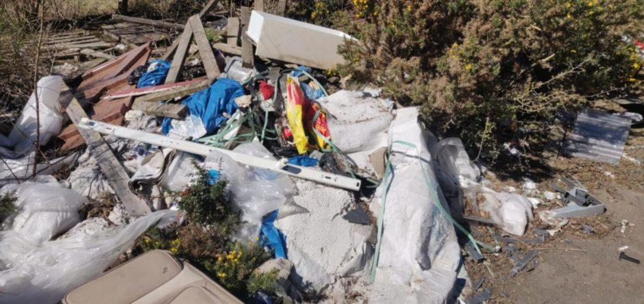 Debris left behind at Calais Woods