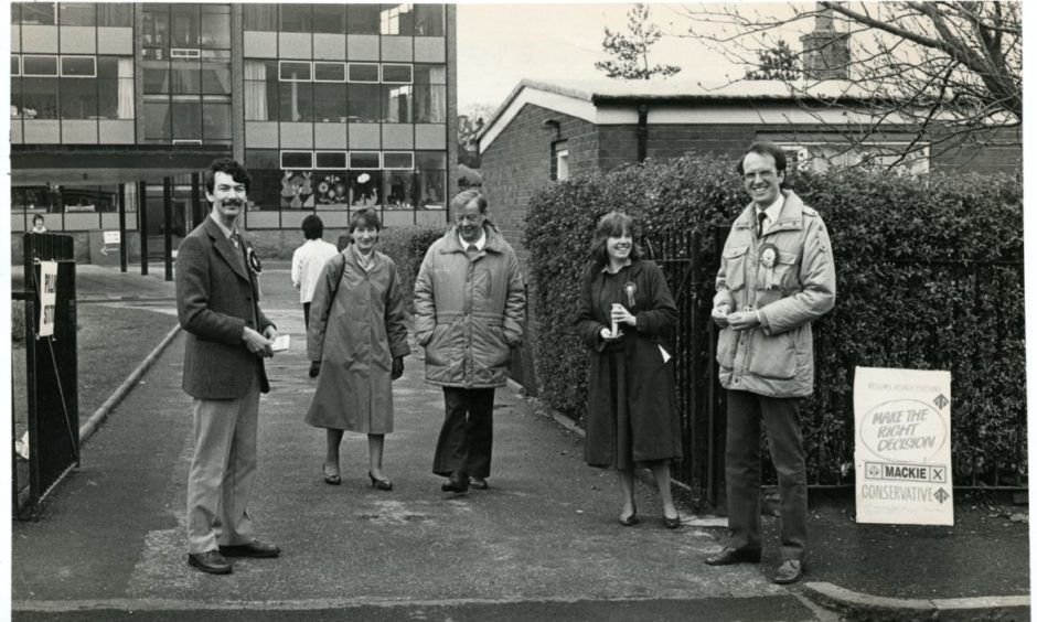 Hopeful candidates waiting for voters outside Forthill Primary in Dundee during the Scottish regional elections on May 8 1986.