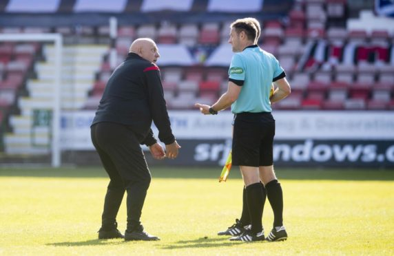 Dick Campbell remonstrates with match officials at East End Park.