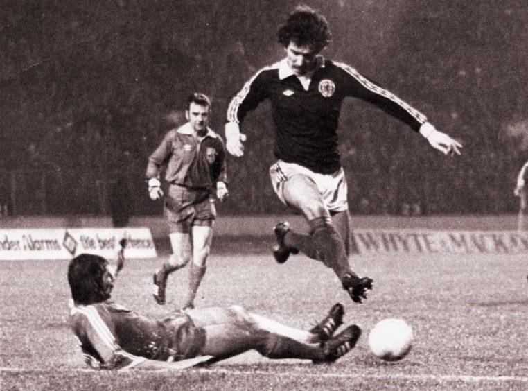 Graeme Souness skipping over Bulgarian Defender's challenge, 1978.