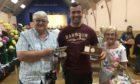 Calum Clunie wth his grandparents Alasdair and Sheila Simpson at the Leven show