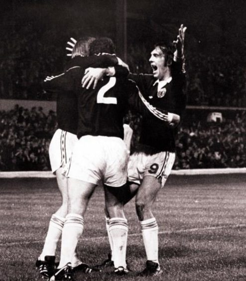 Joe Jordan (left), Scotland v Wales, 1976.
