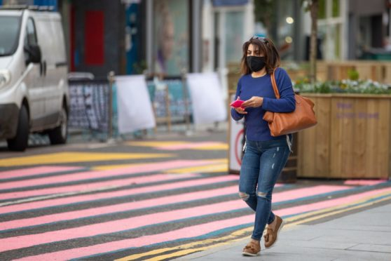 Face coverings and street markings in Dundee.