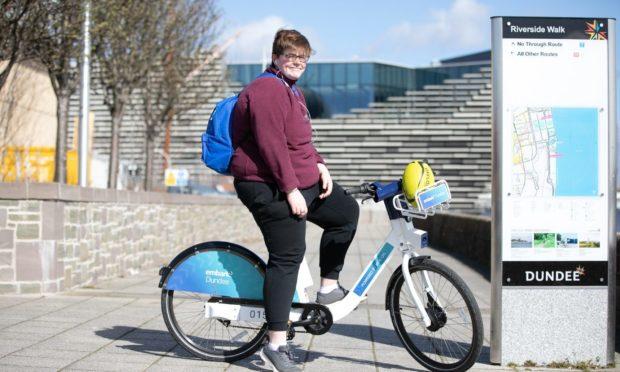 Leah Hall on an e-bike on Riverside Walk in Dundee.