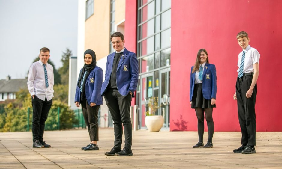 Grove Academy pupils are on top of the world after seeing off international competition to be crowned winners of a virtual debating competition.