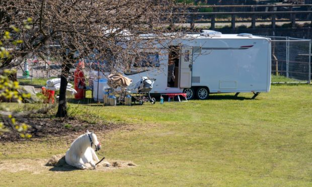 Travellers have set up camp at Leven swimming pool.