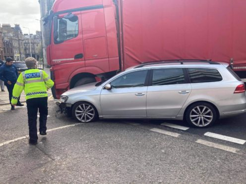 Police were called to a collision between a lorry and a car in the city centre.