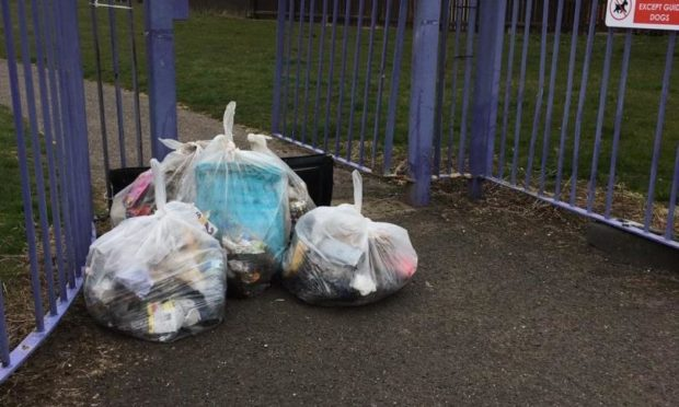 To go with story by James Simpson. Neighbours sick of the rubbish being dumped on the streets. Picture shows; Rubbish found in Mid Craigie. Mid Craigie, Dundee.. Supplied by Supplied Date; Unknown