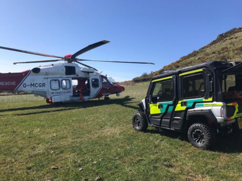 Coastguard helicoper and mountain rescue teams were called into action to bring an injured walker to safety.