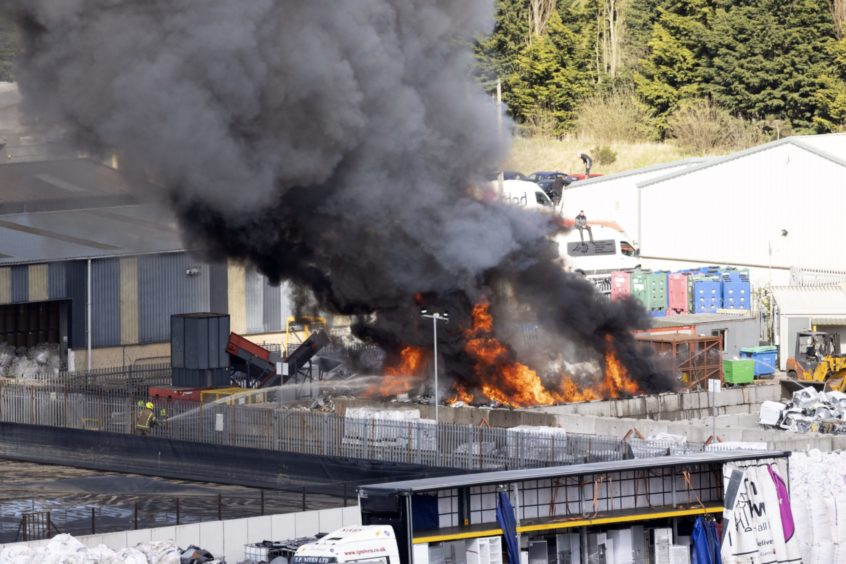Firefighters try to extinguish a blaze at the Shore Recycling electrical waste facility on Shore Road in Perth.