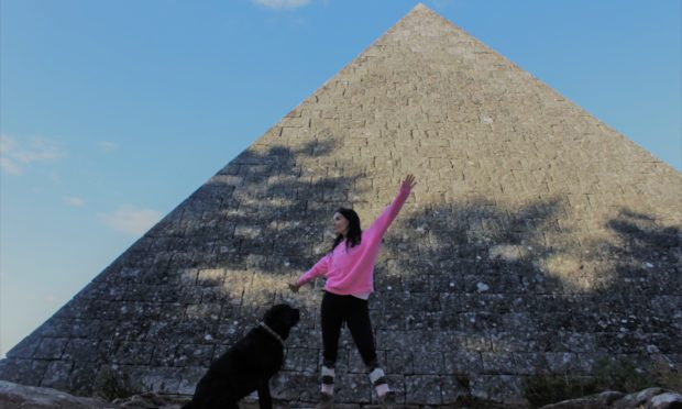 Gayle and her dog Toby at Prince Albert's cairn on the Balmoral estate.