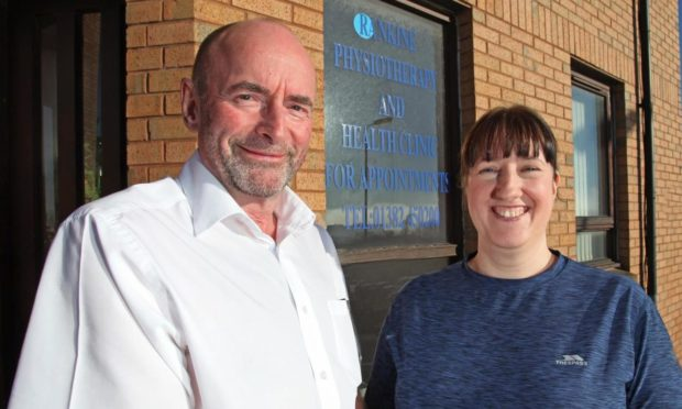 Dave Rankine and Vicki Low, the new owner of the clinic.