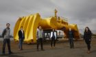 Yan Gunawardena, Cameron McNatt, Jon Clarke and Cinthia Medrado from Mocean Energy with Tim Hurst, managing director of Wave Energy Scotland and Arhontia Athanasiou (Mocean Energy) with the Blue X wave energy converter at Forth Ports Rosyth.