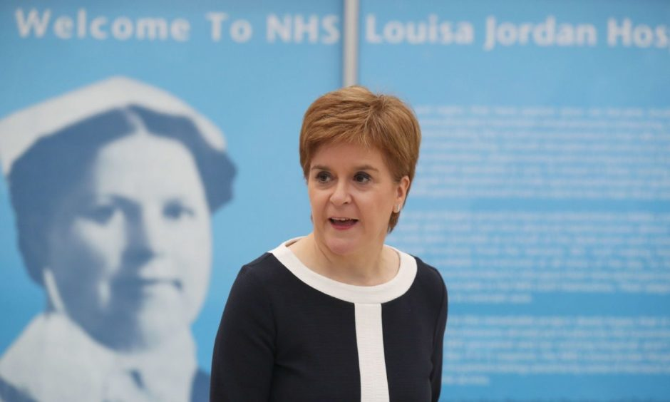 First Minister Nicola Sturgeon during a visit to the NHS Louisa Jordan at the SEC, Glasgow, to learn about the venue being adapted for treating outpatients. PA Photo. Picture date: Monday July 27, 2020. See PA story SCOTLAND Coronavirus. Photo credit should read: Andrew Milligan/PA Wire