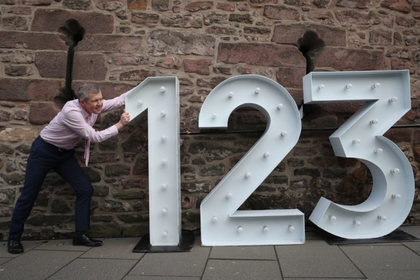 Scottish Liberal Democrat Leader Willie Rennie with giant numbers at the Vennel Viewpoint of Edinburgh Castle, Edinburgh, where he announced his party's pupil premium plans while campaigning for the Scottish Parliamentary election. Picture date: Sunday March 28, 2021. PA Photo. See PA story SCOTLAND Election. Photo credit should read: Andrew Milligan/PA Wire