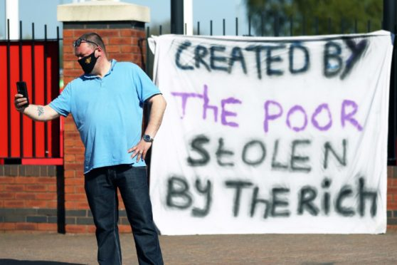 A fan outside Manchester United's Old Trafford ground.