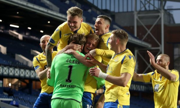 St Johnstone players celebrate with goalkeeper Zander Clark after winning the penalty shoot-out against Rangers