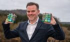 Nick Tulloch, chief executive of Voyager Life Limited, with some of his CBD (part of cannabis plant) products.