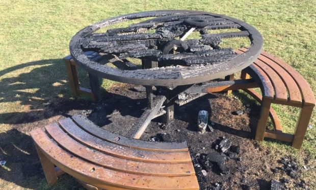 The damaged table and scorched grass in Magdalen Green.