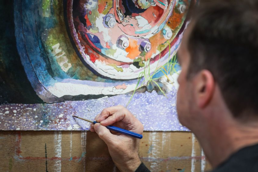 Angus at work on Wheel of Fortune in his studio.