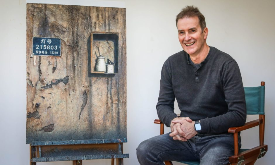 Angus with his piece Shanghai Street Life which reached the final of an American art prize.