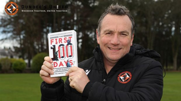 Dundee United manager Micky Mellon poses with his management book: The First 100 Days.