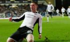 Michael O'Halloran slides in celebration after scoring St Johnstone's third to beat Rangers in 2015.