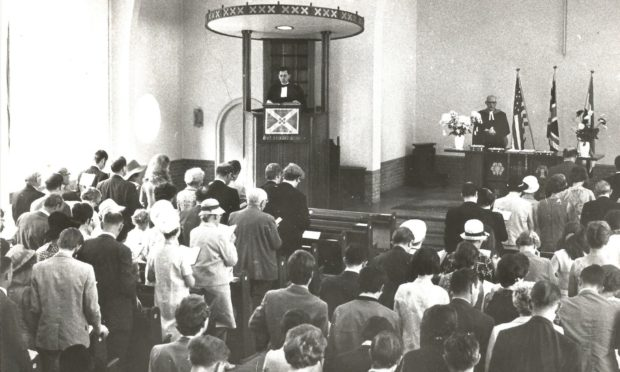 Rev John Russell preaching from the pulpit at the Scots International Church in 1970
