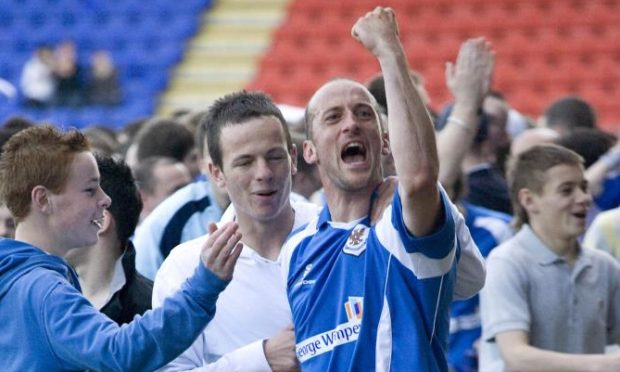 Paul Sheerin celebrates promotion with St Johnstone.