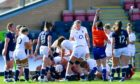Poppy Cleall scores one of England's eight tries in their 52-10 win.