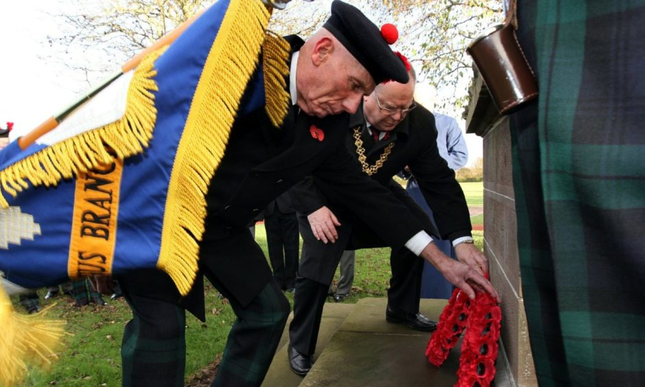 Roland Rose and then Dundee Lord Provost Bob Duncan laid the wreaths at Caird Park war memorial, Dundee.
