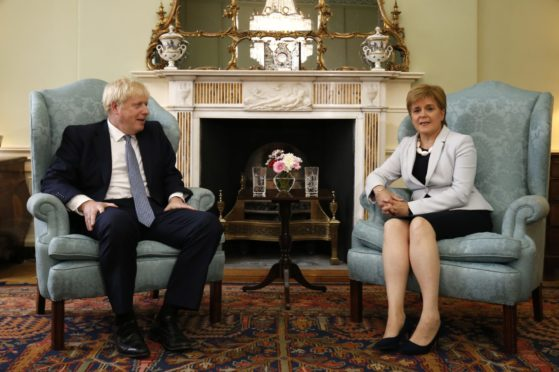Johnson and Sturgeon at Bute House.