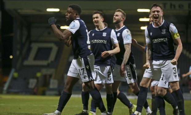 Dundee players celebrate beating Hearts in January.