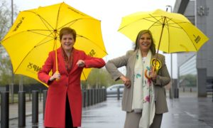 Nicola Sturgeon poses with Kaukab Stewart after Stewart was elected as the MSP for Glasgow Kelvin constituency.