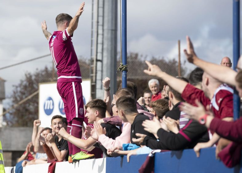 Bobby Linn celebrating scoring a goal with Arbroath supporters
