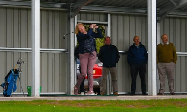 Heather McNiven plays the opening shot at the new range named in honour of her late husband.