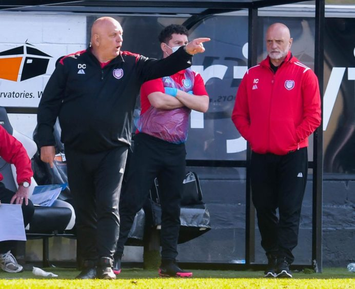 Dick Campbell pointing towards the field as Arbroath manager