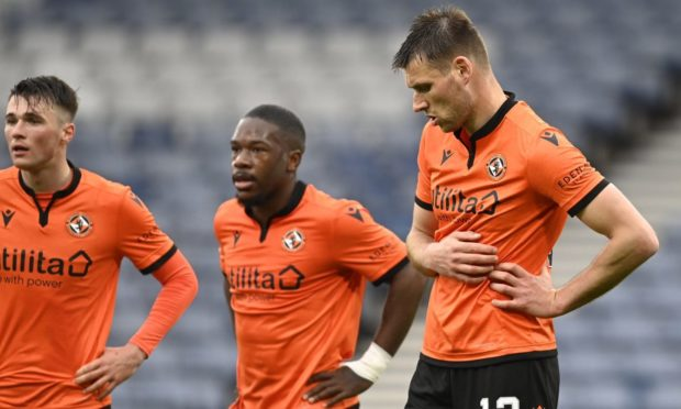 Jamie Robson, Jeando Fuchs and Ryan Edwards look dejected after Dundee United's 2-0 Scottish Cup semi-final defeat to Hibs.