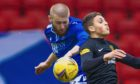Livingston's Jaze Kabia and St Johnstone's Shaun Rooney in action.