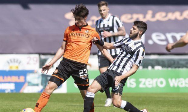 St Mirren's Ryan Flynn closes down Dundee United midfielder Ian Harkes.