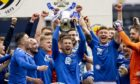 St Johnstone's David Wotherspoon lifts the Scottish Cup after defeating Hibs in the final.